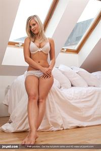 Marry Queen poses in an attic