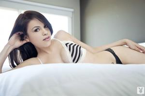Lissette Marie posing in a bedroom for Playboy
