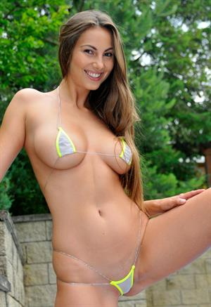 Connie carter strips her micro bikini poolside