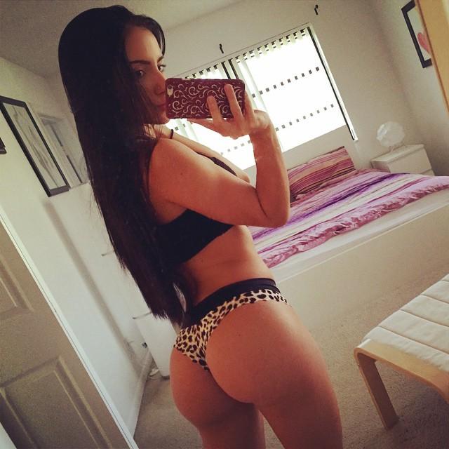 Bruna Lima in a bikini taking a selfie and - ass