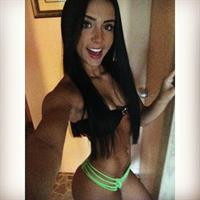 Bruna Lima in a bikini taking a selfie