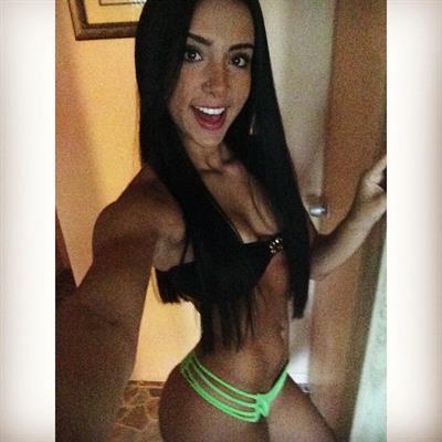 Bruna Lima in a bikini taking a selfie