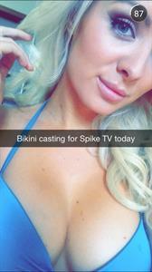 Annelise Marie in a bikini taking a selfie
