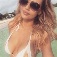 Rachel Mortenson in a bikini taking a selfie