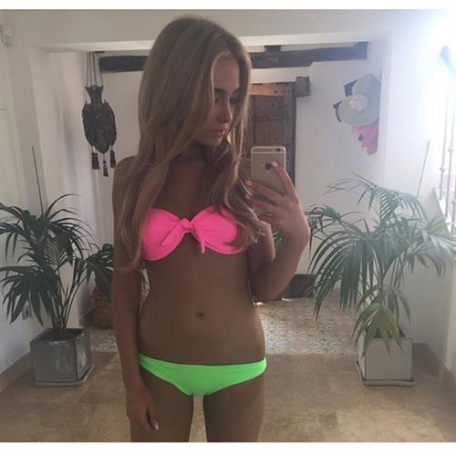 Nicola Hughes in a bikini taking a selfie