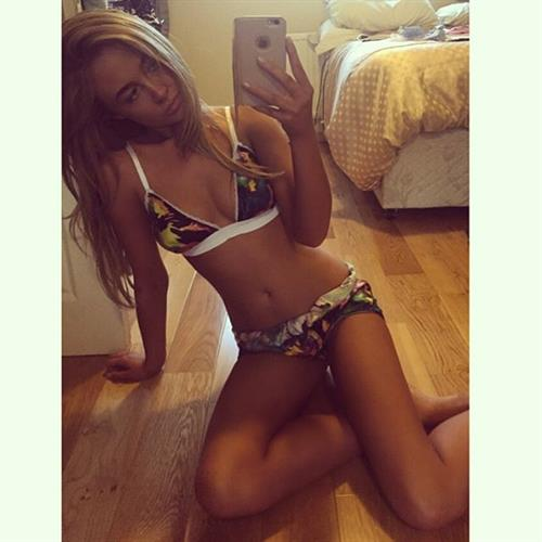 Nicola Hughes in a bikini taking a selfie
