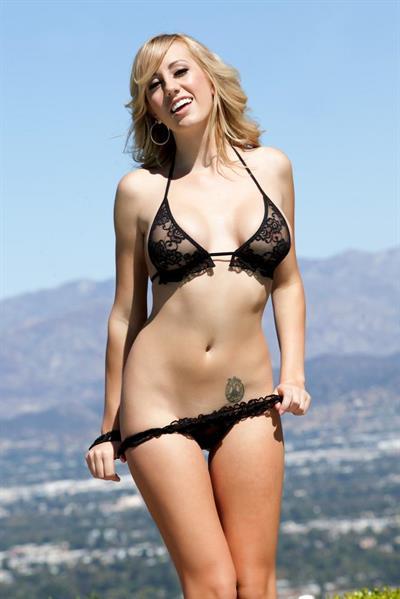 Brett Rossi strips off black lingerie