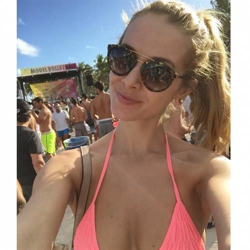 Olivia Jordan in a bikini taking a selfie