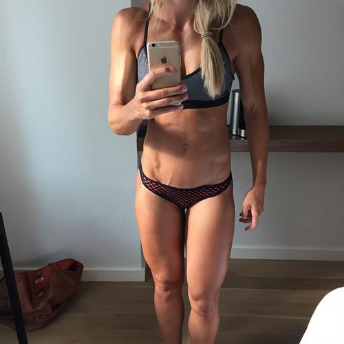 Adrienne Koleszár in a bikini taking a selfie
