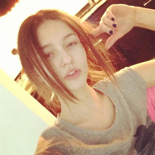 Kristina Romanova taking a selfie