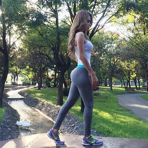 Yanet Garcia in Yoga Pants taking a selfie