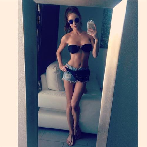 Laura Carter in a bikini taking a selfie