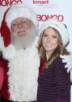 Audrina Patridge poses with Santa Claus