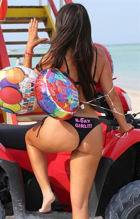 Claudia Romani celebrating her birthday on the beach