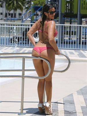 Claudia Romani takes a dip in a pool