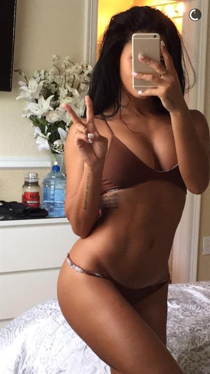 Katya Elise Henry in a bikini taking a selfie