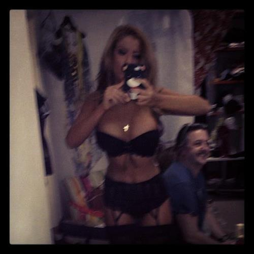 Teodora Andreeva in lingerie taking a selfie