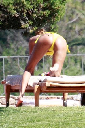 Aida Yespica - Yellow bikini candids in Sardinia on June 18, 2012