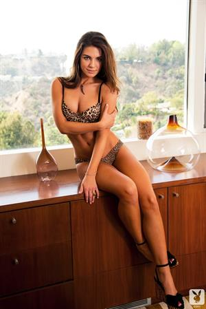 Jessica Ashley strips down on a counter top for Playboy