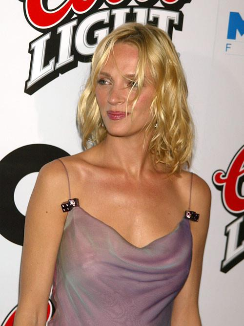 Uma Thurman in a purple dress