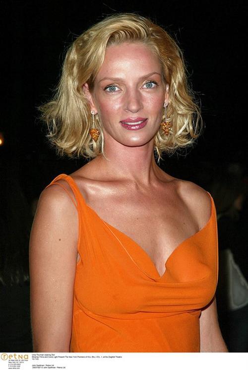 Uma Thurman in an orange dress