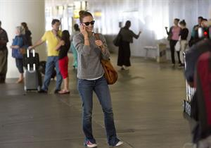 Olivia Wilde - Arrives at LAX Airport - August 13,2012