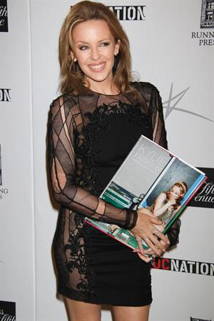 Kylie Minogue in a tight black mini dress for the launching of her book 'Kylie Fashion' at Saks Fifth Avenue