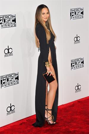 Chrissy Teigen wardrobe malfunction flashes at 2016 American Music