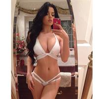 Demi Rose Mawby in a bikini taking a selfie