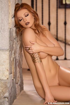 Ravishing Redhead Chandler South proudly displays her colossal boobs in sexy-high heels for Playboy
