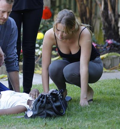 Jennifer Lawrence in Santa Monica helping a woman who fainted on June 25, 2012