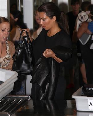 Kim Kardashian - JFK airport in New York on August 9, 2012
