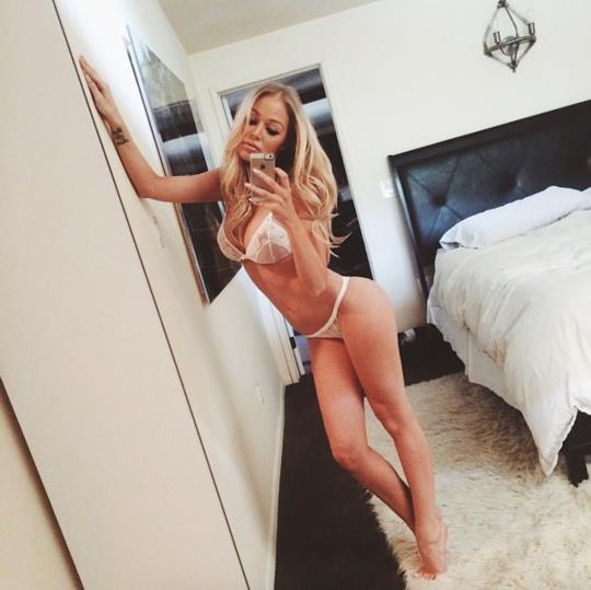 Amy-Jane Brand in a bikini taking a selfie