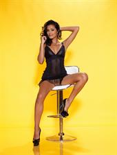 Belinda A nude poses in black lingerie with a yellow background
