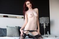 Nico Faye in black lingerie on her bed