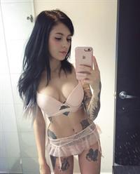 Sara Calixto in lingerie taking a selfie