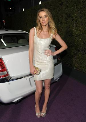Amber Heard Vanity Fair Campaign Hollywood Pieces of Heaven art auction on February 23, 2011