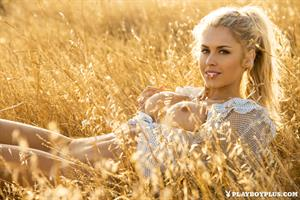 Playboy Cybergirl Kayla Rae Reid Nude in a field