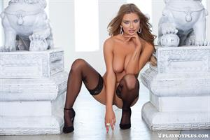 Playboy Cybergirl Brittney Shumaker Nude posing with a statue