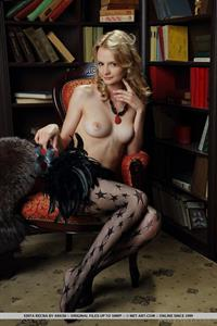 Edita Recna nude in a library for Met-Art