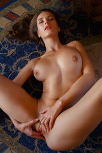 Pretty Elina gets naked on the floor