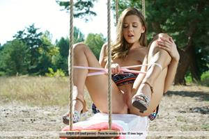 Davina E nude on a swing