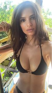 Emily Ratajkowski in a bikini taking a selfie