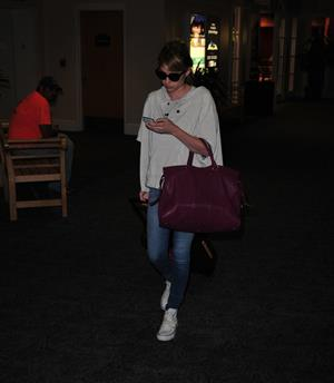 Emma Roberts lands in Wilmington to continue filming 'We're the Millers' (09 August 2012)