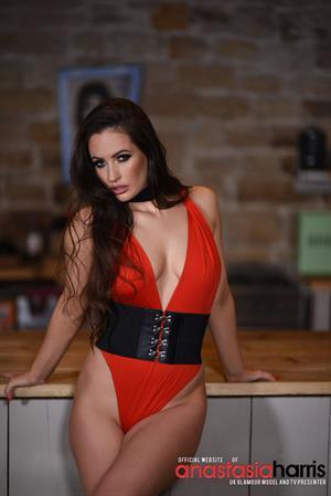 Anastasia Harris in sexy red bodysuit
