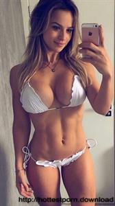 Nazanin Kavari in a bikini taking a selfie