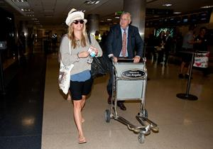 Kaley Cuoco at LAX on April 26, 2012