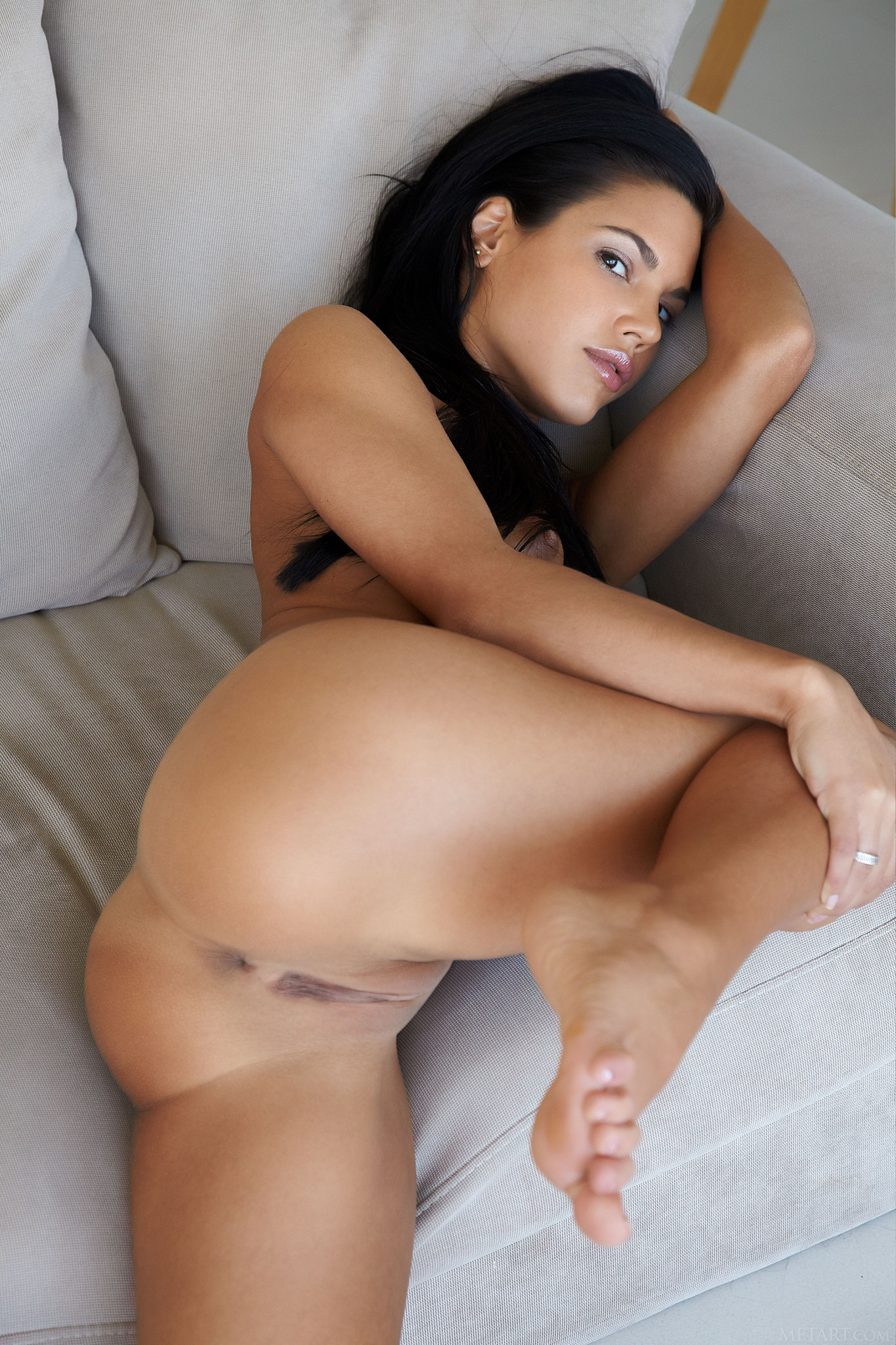 Black haired plays with anal plug 4