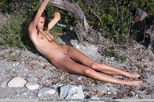 Altea B nude roaming the rocky landscape