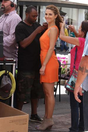 Maria Menounos in several outfit on the set of EXTRA at the Grove in LA on May 15, 2013